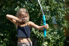 Girl aim with bow. On background of nature Royalty Free Stock Images