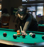 Girl aiming for billiard table Stock Photography
