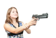 Girl aiming a black gun. Focus on gun only Royalty Free Stock Images