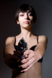 Girl aiming a , focus on the gun Royalty Free Stock Photo