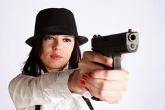 Girl aiming with the gun Royalty Free Stock Photography