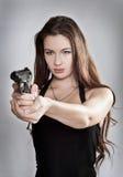 Girl aiming a gun. Focus on the person stock photos