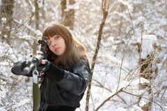 Girl aiming a gun Stock Photo