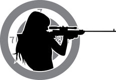 Girl aims from a rifle. With target background silhouette Royalty Free Stock Photo