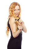 Girl Aims a Slingshot. Beautiful blond girl with slingshot, isolated on white Royalty Free Stock Photography