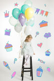 Girl with air balloons Royalty Free Stock Images