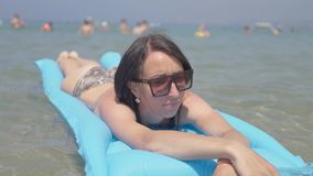 Girl on air mattress in sea. Family vacation concept. Girl on air mattress in sea. Family vacation concept stock video