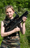 The girl with an air rifle. The nice young fair-haired girl with an air rifle Royalty Free Stock Photo