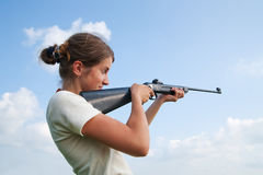 Girl with air rifle Stock Images