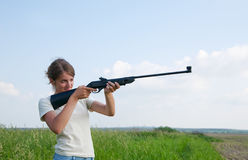 Girl with air rifle Royalty Free Stock Image