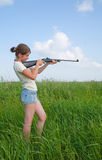 Girl with air rifle Royalty Free Stock Photos