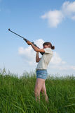 Girl with air rifle Royalty Free Stock Photography