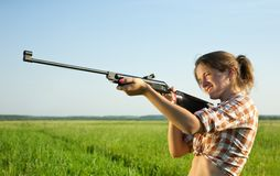 Girl with air rifle Stock Photo