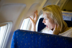 Girl in the airplane Stock Images