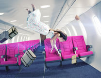 The girl in an airplane. Flying  girl in an airplane. Creative concept Stock Image