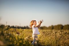 Girl and airplane Royalty Free Stock Image
