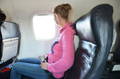 Girl in the airplane Royalty Free Stock Photography
