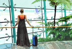 Girl at the airport Royalty Free Stock Image