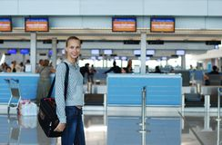 Girl in airport Stock Images