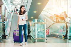 Girl in airport. Asian woman were carrying luggage around the international airport. She was traveling abroad to travel on weekends stock images