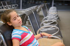 Girl at the airport Stock Images