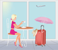 Girl at the airport are going on vacations. Stock Image