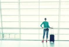 Girl in the airport Stock Photos