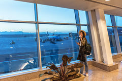 Girl in airport terminal Stock Photo