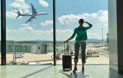 Girl in the airport royalty free stock image
