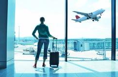 Girl at the airport stock photos