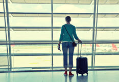 Girl in the airport Stock Images