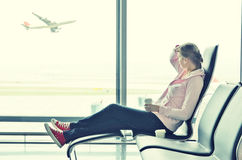 Girl in the airport royalty free stock photography