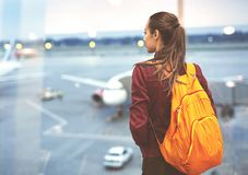 Girl at the airport window Royalty Free Stock Image