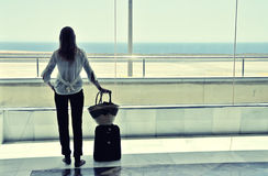 Girl at the airport window Royalty Free Stock Photo