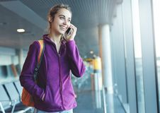 Girl at the airport window Stock Images
