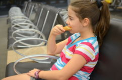 Girl at the airport. Young teenaged girl eating pizza while waiting for her flight Stock Photography