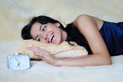 Girl and alarm clock Royalty Free Stock Image
