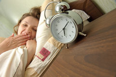 Girl and alarm clock Royalty Free Stock Photography