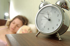 Girl and alarm clock Stock Photo