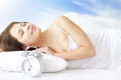 Girl with Alarm Clock Stock Photography