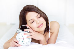 Girl with Alarm Clock Royalty Free Stock Photos