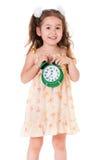 Girl with alarm clock Stock Image