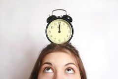 The girl and an alarm clock. Stock Photography