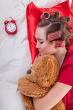Girl with Alarm Clock Stock Images