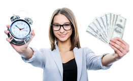 Girl with an alarm and money Royalty Free Stock Images