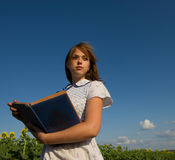 Girl with an album Stock Photo