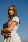 Girl with the album in the hands of Royalty Free Stock Photos