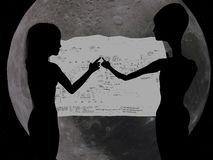 Girl and alien checking CAD. Teamwork !  A human and an alien girl review a CAD drawing Royalty Free Stock Photo