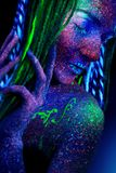 The girl aliens asleep. Hands near the face, ultraviolet make-up royalty free stock photography