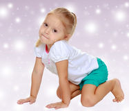 The girl is on all fours Royalty Free Stock Image